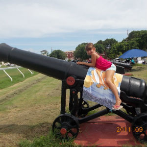 Girl on Cannon at Historic Garrison, Barbados